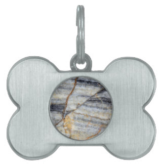 Marble surface with fractures. pet tag