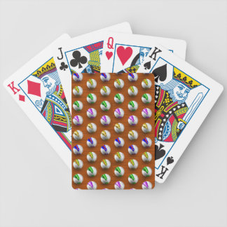 Marbles on floor boards bicycle playing cards