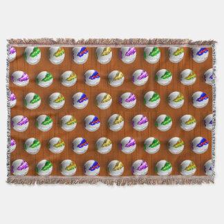 Marbles on floor boards throw blanket