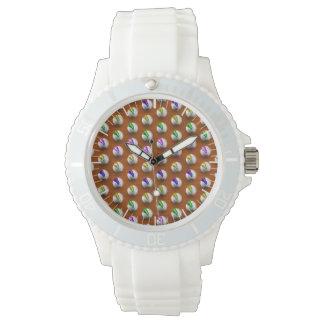 Marbles on floor boards wrist watch