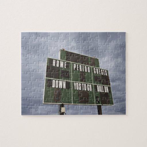 Marcador del fútbol y nubes de tormenta puzzles con fotos
