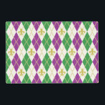 """Mardi Gras Argyle Laminated Place Mat<br><div class=""""desc"""">Bright purple and green diamonds overlaid with gold-toned diamond outlines and fleur de lis bring to mind the revelry and celebrations associated with a New Orleans Mardi Gras, while a cream base adds a touch of refinement to this argyle pattern. On the back a faded version of the argyle sits...</div>"""