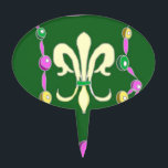 """Mardi Gras Beads and Fleur De Lis Cake Topper<br><div class=""""desc"""">These lovely products feature a strand of beads in traditional Mardi Gras colours,  mauve,  green and gold,  with a large Fleur de lis in the centre. Perfect for Mardi gras or Fat Tuesday</div>"""
