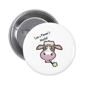 Margarita, la vaca, insignia del mercado pins