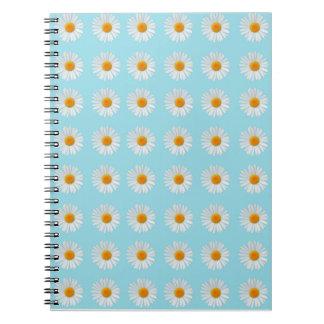 Margaritas minúsculas por todo su cuaderno