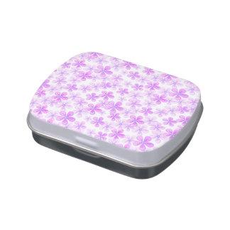 Margaritas rosadas y púrpuras bonitas latas de caramelos