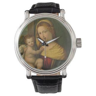 Maria que detiene al bebé Jesús Relojes