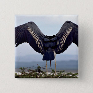 Maribu stork with outstretched wings pinback button