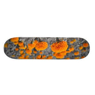 Marigold floral design on board