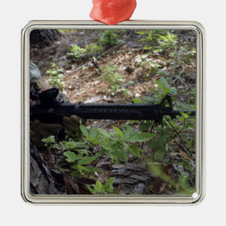 Marine uses a tree for cover and concealment metal ornament