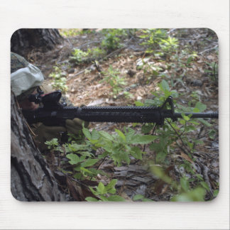 Marine uses a tree for cover and concealment mouse pad