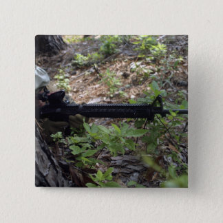 Marine uses a tree for cover and concealment pinback button