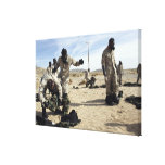 Marines and Sailors assist each other Canvas Print