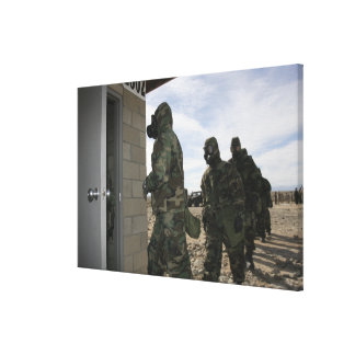 Marines and Sailors file into the gas chamber Canvas Print