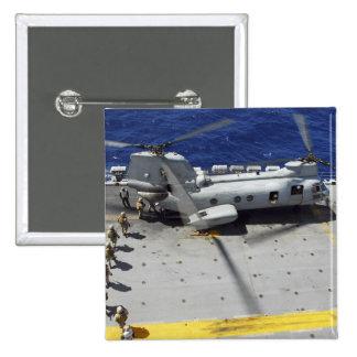 Marines board a CH-46E Sea Knight helicopter 2 Inch Square Button