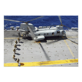 Marines board a CH-46E Sea Knight helicopter Photo Print