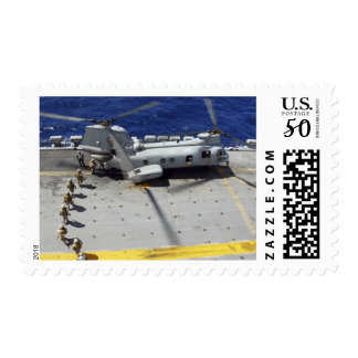 Marines board a CH-46E Sea Knight helicopter Postage