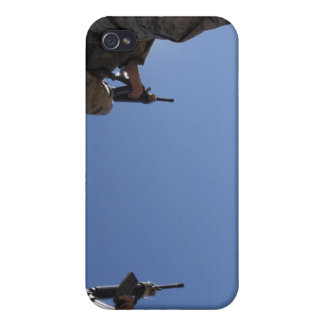 Marines change magazines in the midst of firing case for iPhone 4