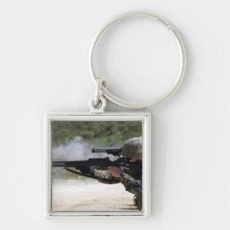 Marines firing shotguns keychain