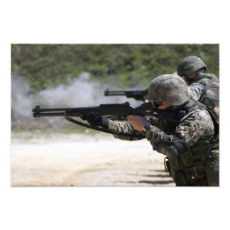 Marines firing shotguns photo