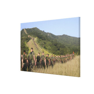 Marines hike their way to a memorial site canvas print