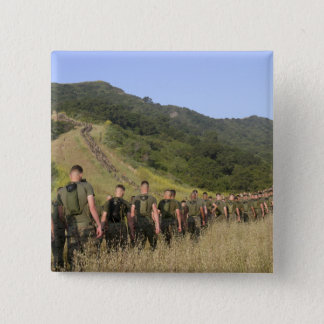 Marines hike their way to a memorial site pinback button