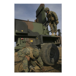 Marines prepare the antenna of an AN/TPQ-46A Print