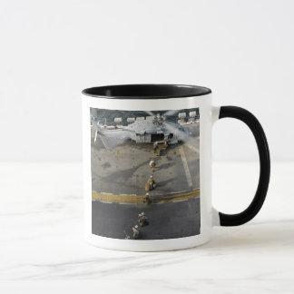 Marines prepare to board an MH-60S Mug
