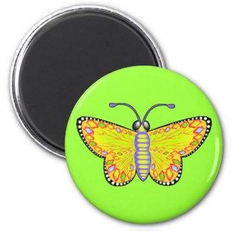 Mariposa amarilla luminosa imán redondo 5 cm