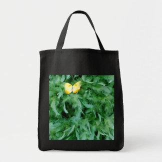 Mariposa amarilla y boa verde bolsa tela para la compra