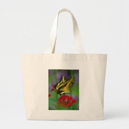 Mariposa amarilla y negra bolsas lienzo