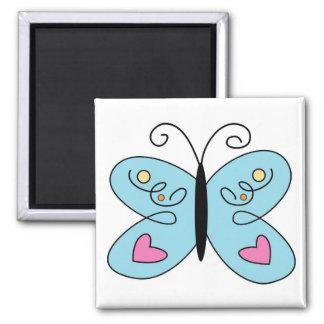 Mariposa azul caprichosa con las alas del corazón imán cuadrado