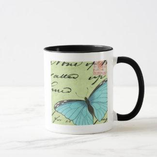 Mariposa Azul-Coa alas en la postal del trullo Taza