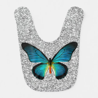 Mariposa azul en el babero de plata del bebé del