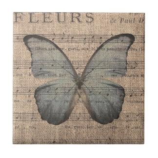 Mariposa azul en partitura del vintage azulejo cuadrado pequeño