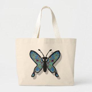 Mariposa azul floral del tema bolsas de mano
