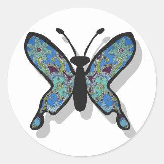 Mariposa azul floral del tema pegatina redonda