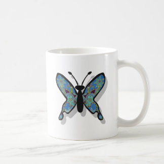 Mariposa azul floral del tema taza de café
