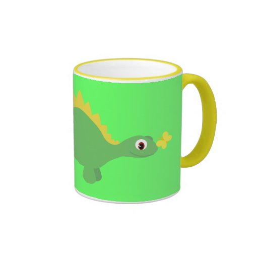 Mariposa bonita del dinosaurio y taza verde y amar