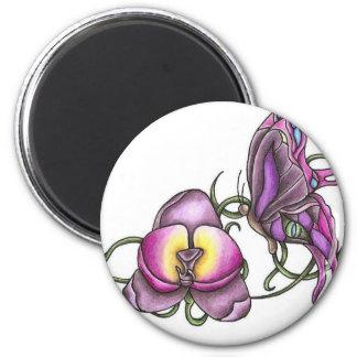 Mariposa con el imán redondo de la orquídea