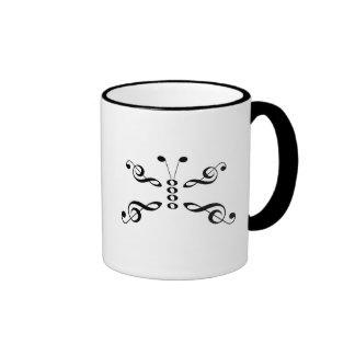 Mariposa de los símbolos de música taza de café