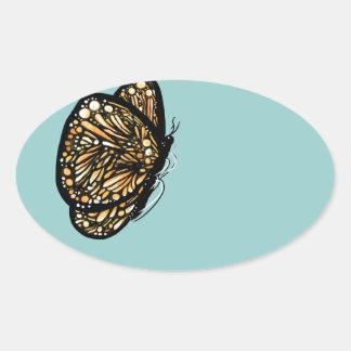 Mariposa de monarca, apenas aterrizada pegatina ovalada