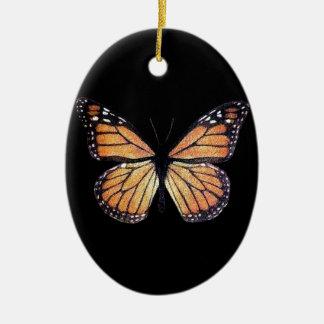 Mariposa de monarca bonita en negro adorno navideño ovalado de cerámica