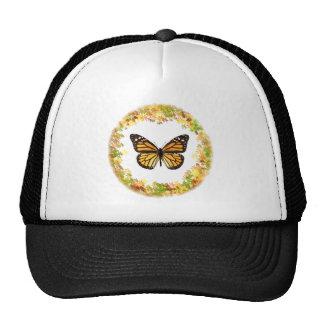 Mariposa de monarca en el marco de hojas gorro