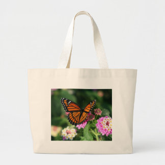 Mariposa de monarca en la flor del Lantana Bolsa Tela Grande