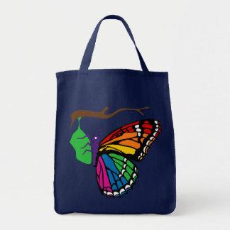 Mariposa del arco iris que emerge de crisálida bolsa de mano