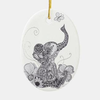 Mariposa del elefante adorno navideño ovalado de cerámica