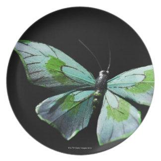 Mariposa del vuelo plato de comida