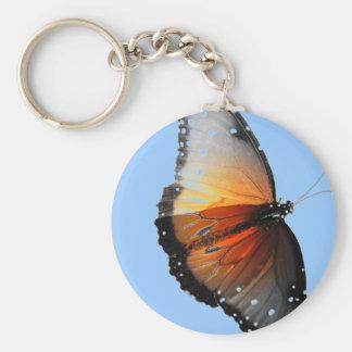 Mariposa descolorada llavero redondo tipo pin