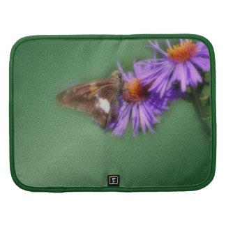 Mariposa en folio del carrito de la naturaleza de  organizador